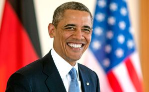 BERLIN, GERMANY - JUNE 19: U.S. President Barack Obama smiles as he signs the official guest book at Bellevue Palace on June 19, 2013 in Berlin, Germany. U.S. President Barack Obama is visiting Berlin for the first time during his presidency and his speech at the Brandenburg Gate is to be the highlight. Obama will be speaking close to the 50th anniversary of the historic speech by then U.S. President John F. Kennedy in Berlin in 1963. (Photo by Thomas Imo/Photothek via Getty Images)