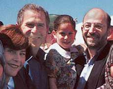 Slug: St/Alarian Deadline: 7/23/02 Contact: Dr. Al-Arian. Cell phone is 813-300-9393. We have permission to use. caption: Sami Al-Arian, holding daughter Lama, 6, center, with son Abdullah, 19, left, daughter Laila, 18, foreground left, daughter Leena, 14, center, wife Nahla, center right, and son Ali, 9, foreground left, pose for a photo with presidential candidate George W. Bush and wife Laura in this March 12, 2000 family photo in Plant City, Fla. Others, extreme right, are unidentified. (AP Photo/Sami Al-Arian) ORG XMIT: FLSM101