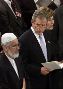 394430 04: US President George W. Bush (C) watches as Muzammil Siddiqi, Imam of the Islamic Society of North America, passes by during a memorial service for victims of the attack on the United States September 14, 2001 in Washington, DC. (Photo by Mark Wilson/Getty Images)